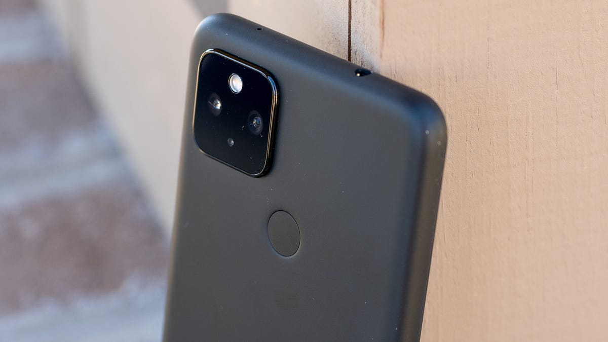 A Pixel 4a 5G against a door