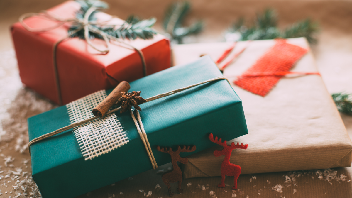Classy holiday gifts presents on brown paper
