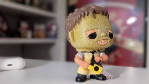 A sample picture from the Pixel 5: A Leatherface collectible on a white desk using portrait mode to blur out the background