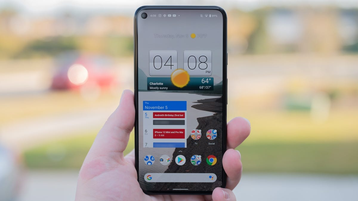 A Pixel 5 phone, with a weather widget on the screen.