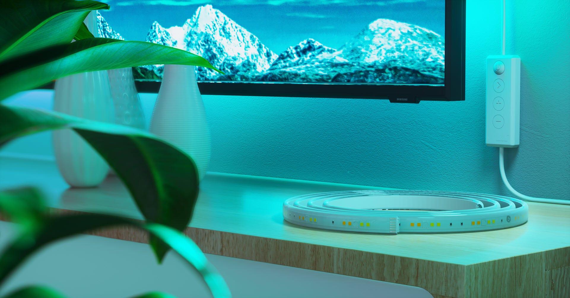 A Nanoleaf LED strip on a tv media center.