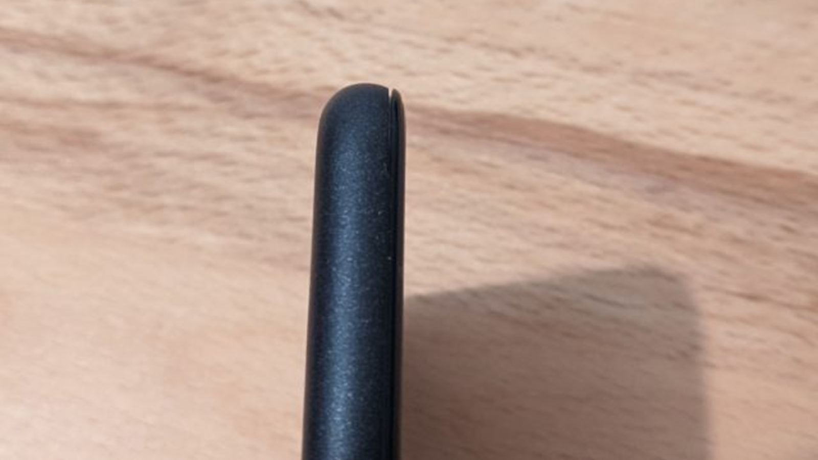 A closeup of a Pixel 5 with a small gap in the screen connection to the phone.