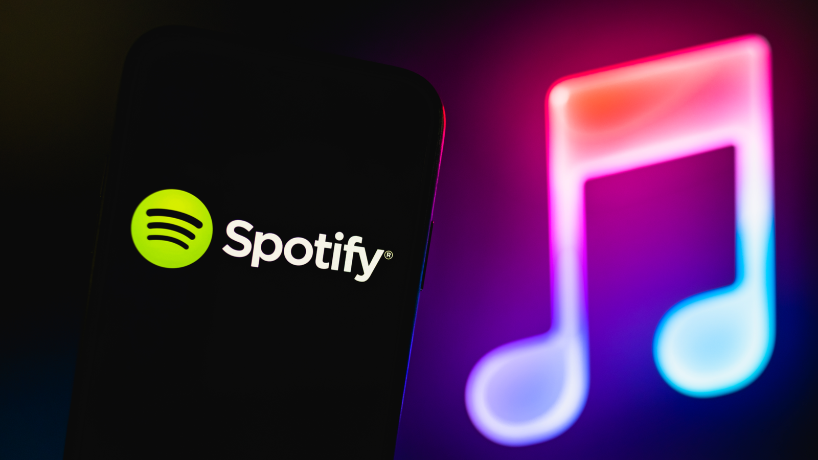 Spotify logo in front of neon screen with two musical notes