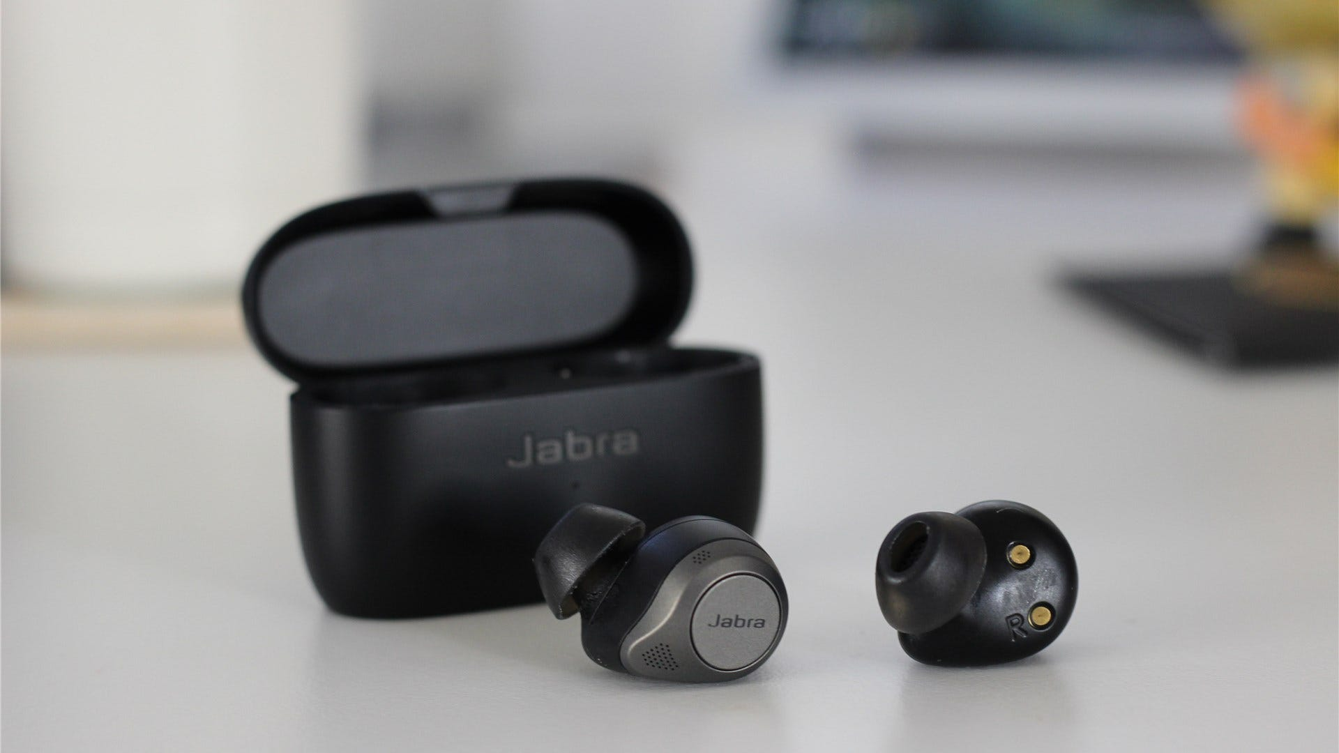 The Elite 85t earbuds out of the case, showing the buttons and the ear tip