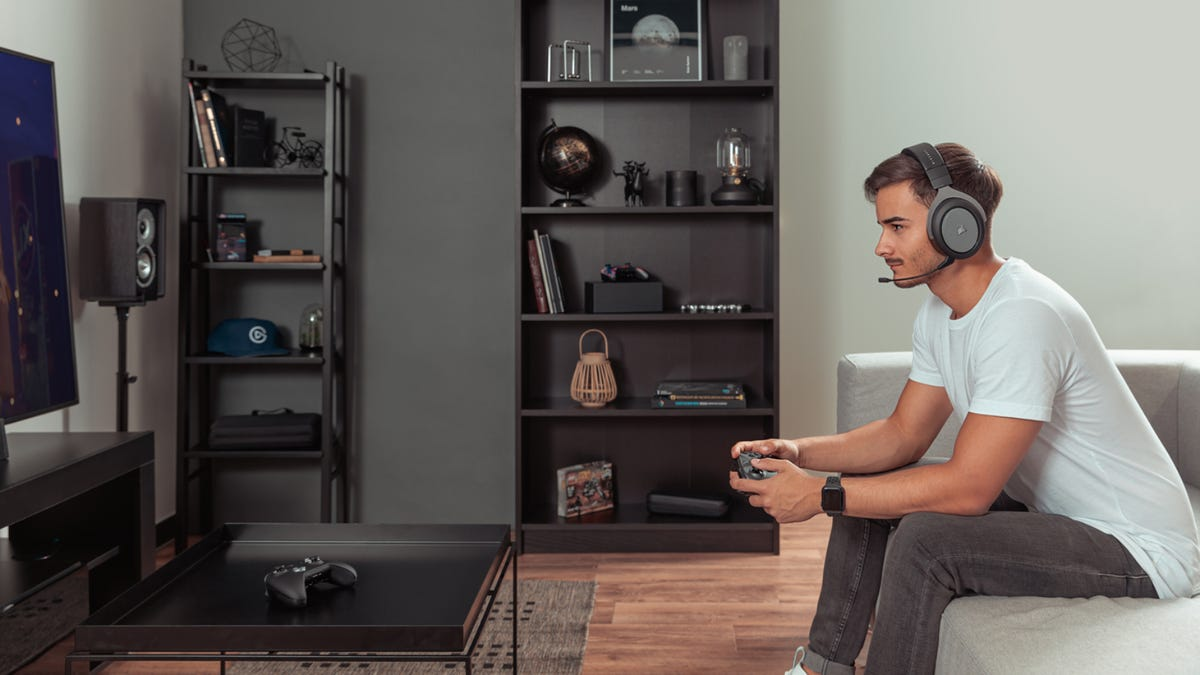 Man playing on the Xbox Series X in living room.