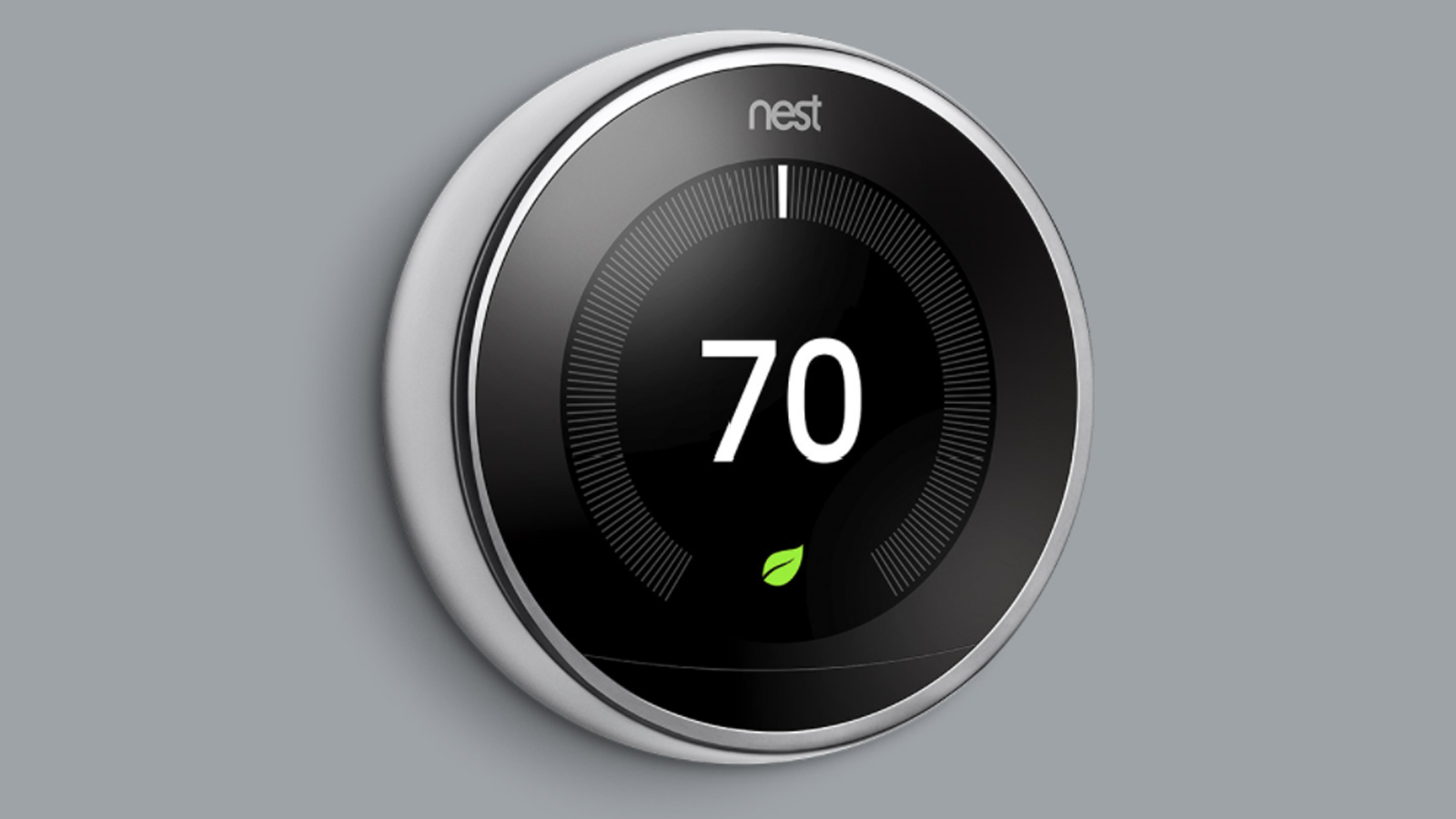 Nest Learning Thermostat, 3rd gen, mounted to grey wall