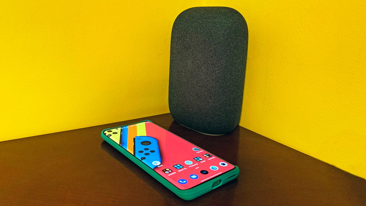Nest Speaker with Android phone in case, yellow background