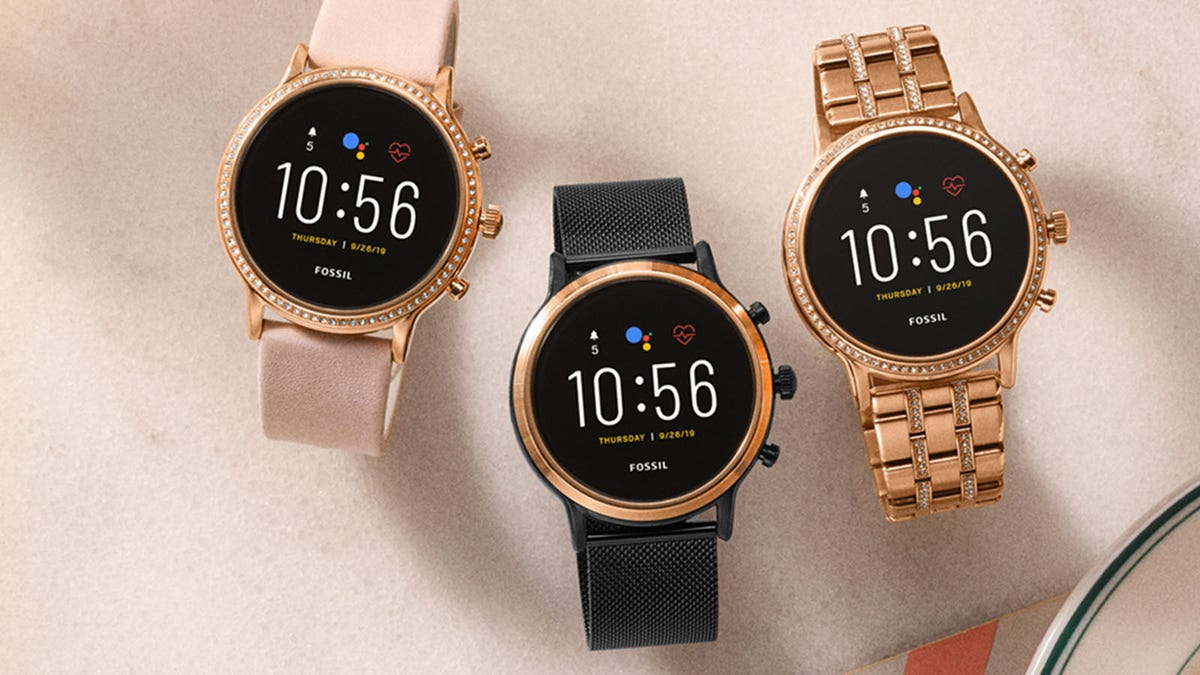 Three Gen 5 Fossil smartwatches in various colors.