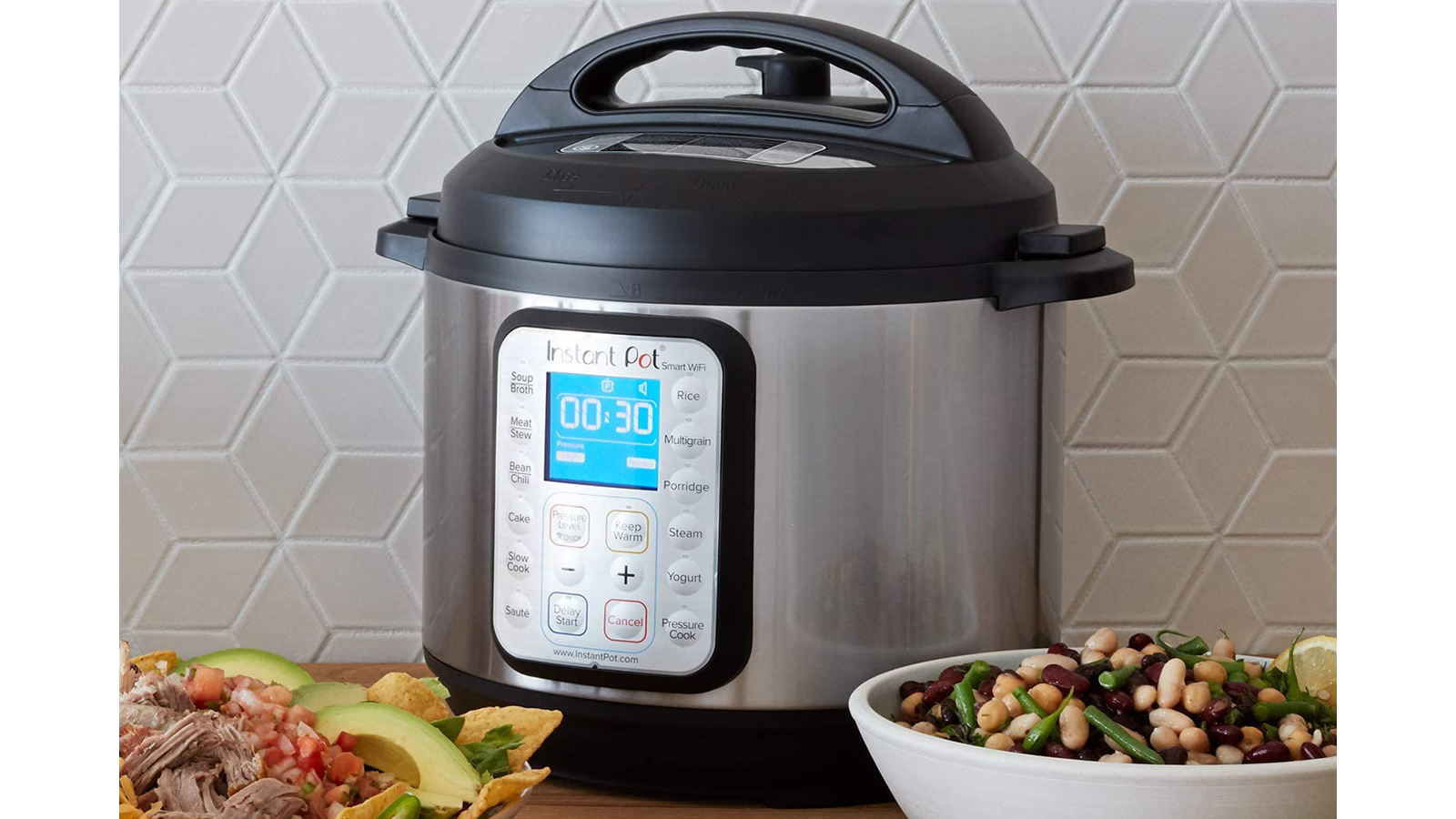 Instant Pot Smart WiFi on table next to two bowls of cooked food