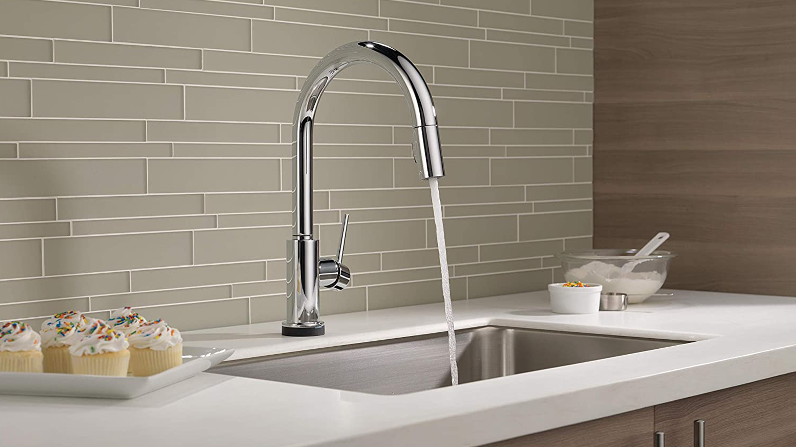 Delta VoiceIQ Faucet with running water in kitchen