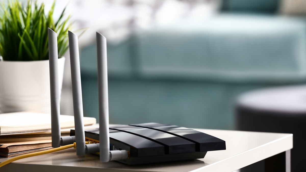 A photo of a router on a table.