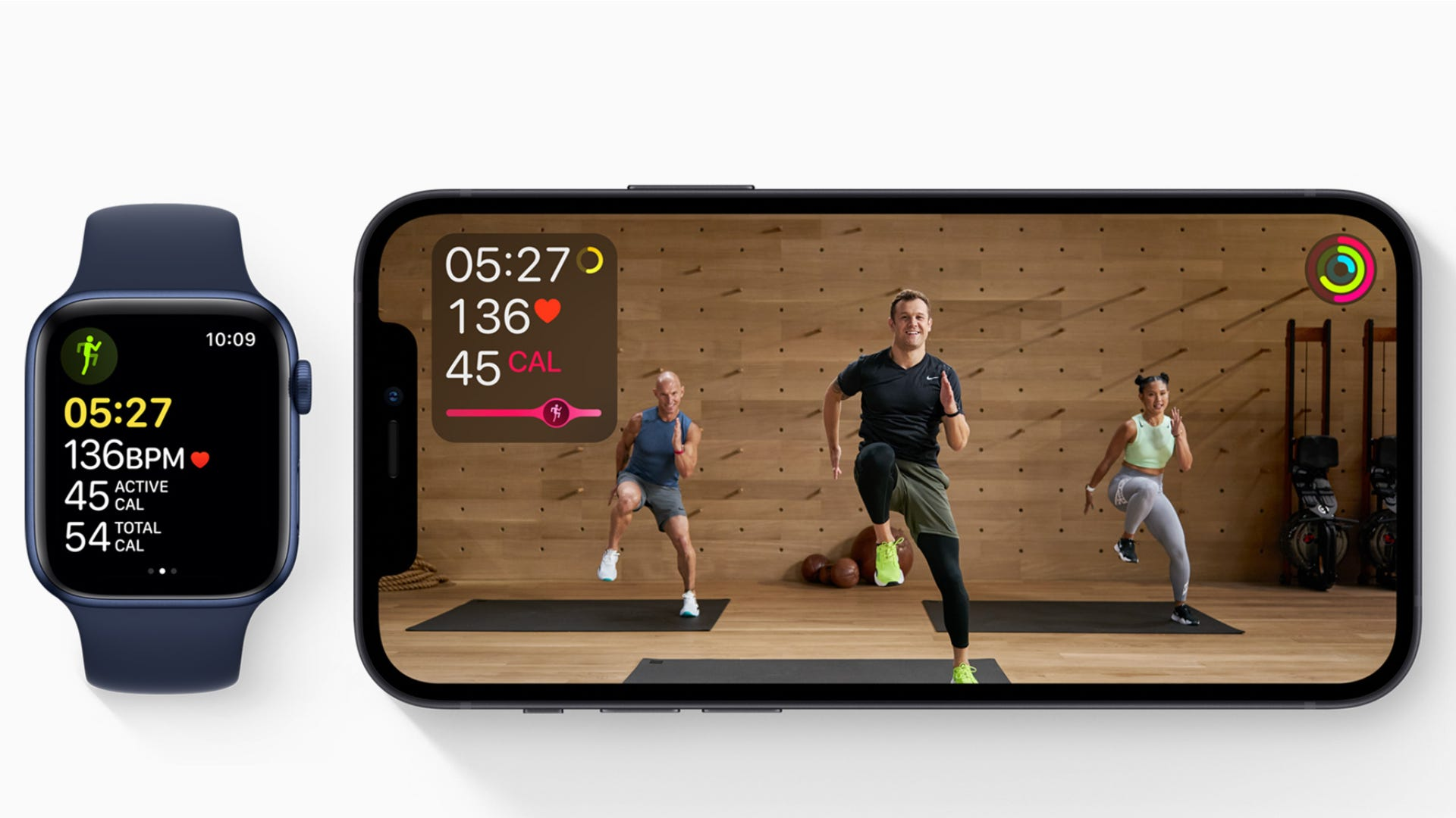 Apple Fitness+ video with Apple Watch next to it with active workout