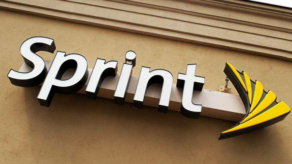 A photo of the Sprint logo outside of a Sprint store.