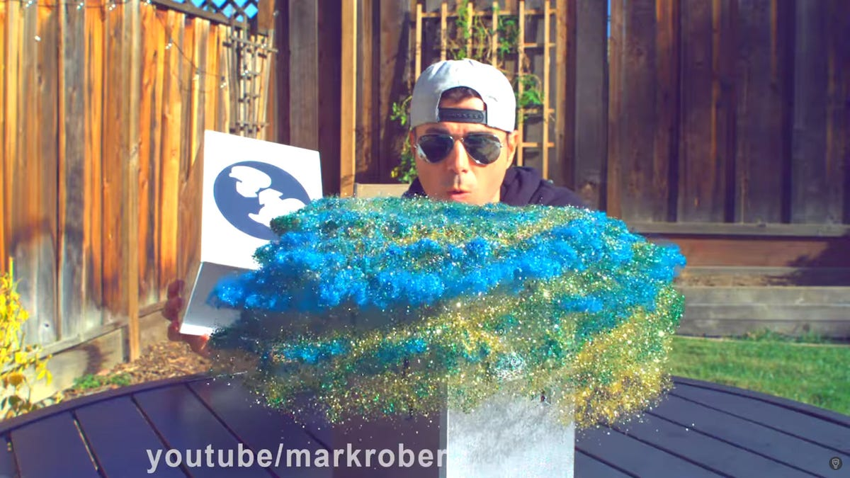 Mark Rober opening up a glitter bomb and glitter spraying everywhere