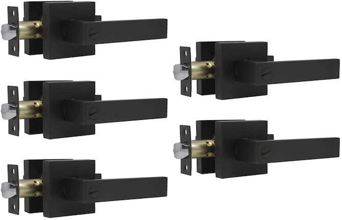 five blocky black door handle levers