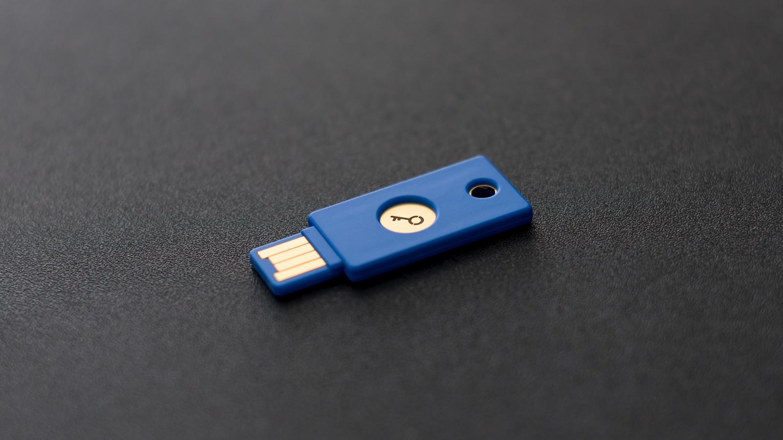 USB security key on dark background