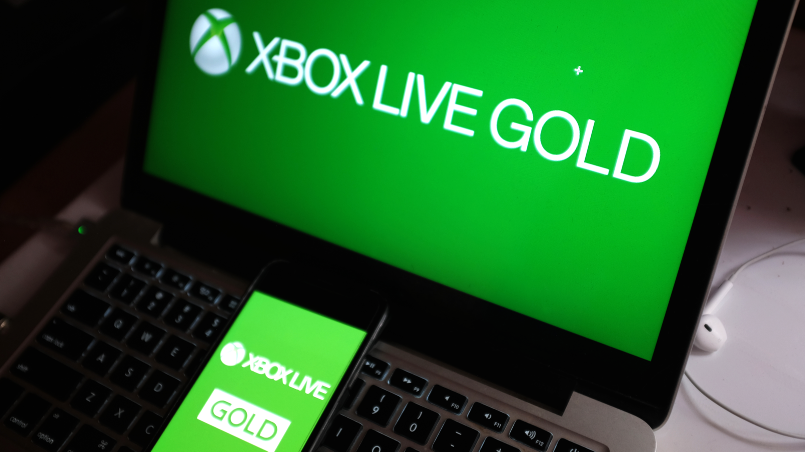 Smart phone with the XBOX LIVE GOLD logo that is the online service of the Xbox One console