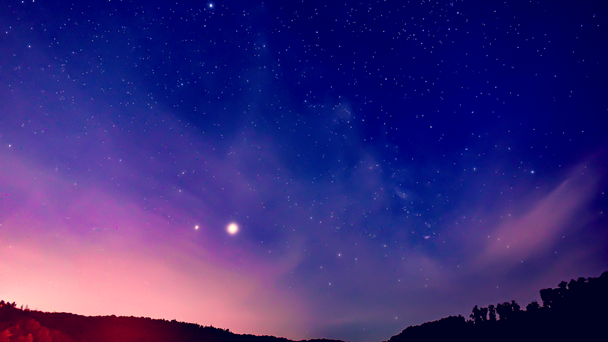 Saturn and Jupiter in the night sky, along with a Springtime Milky Way