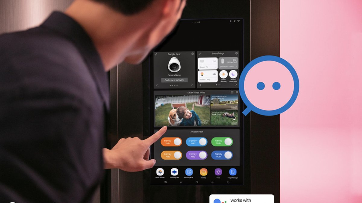 A man looking at a Nest camera stream on a smart refrigerator.
