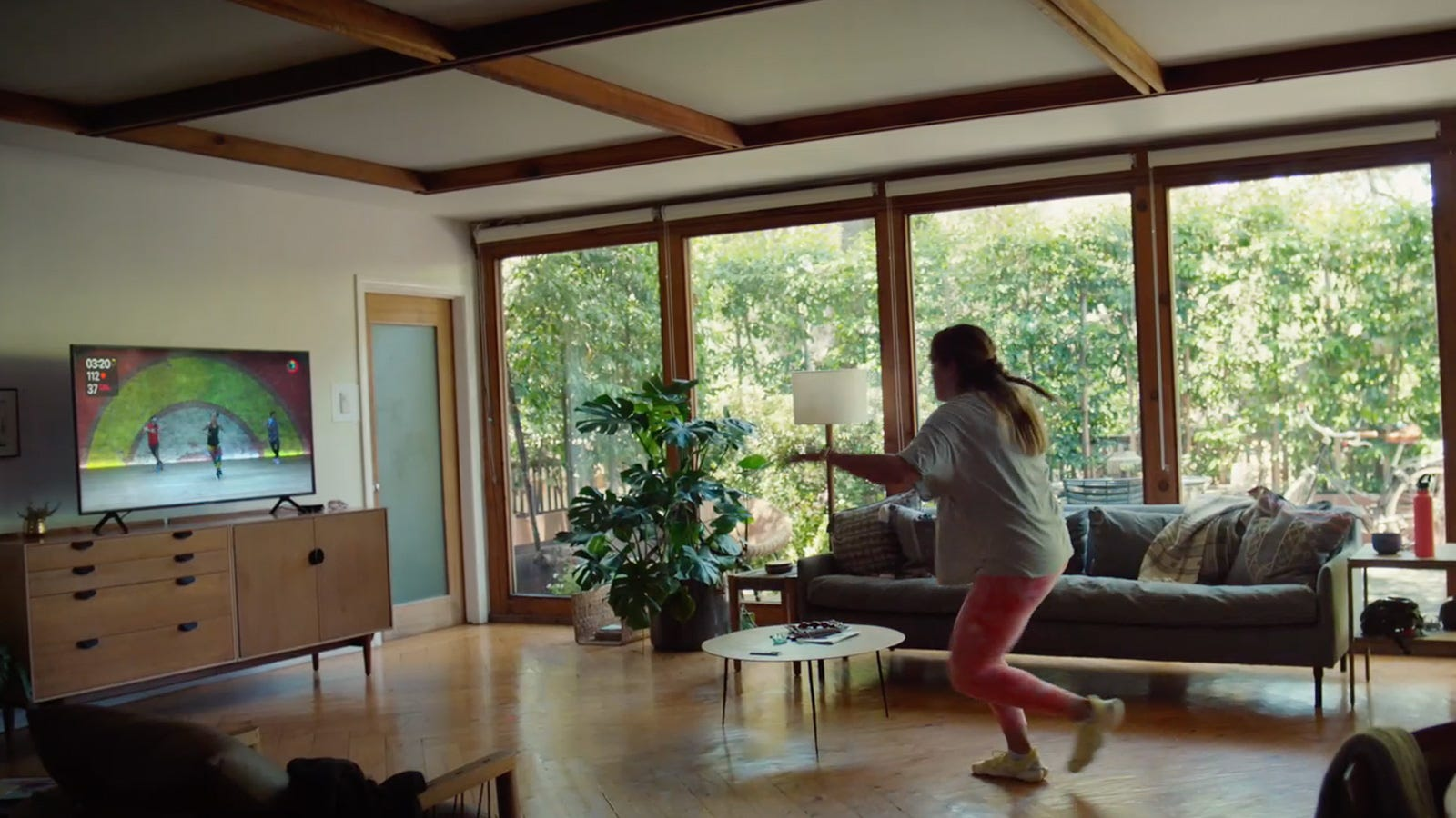 person working out in front of Apple TV