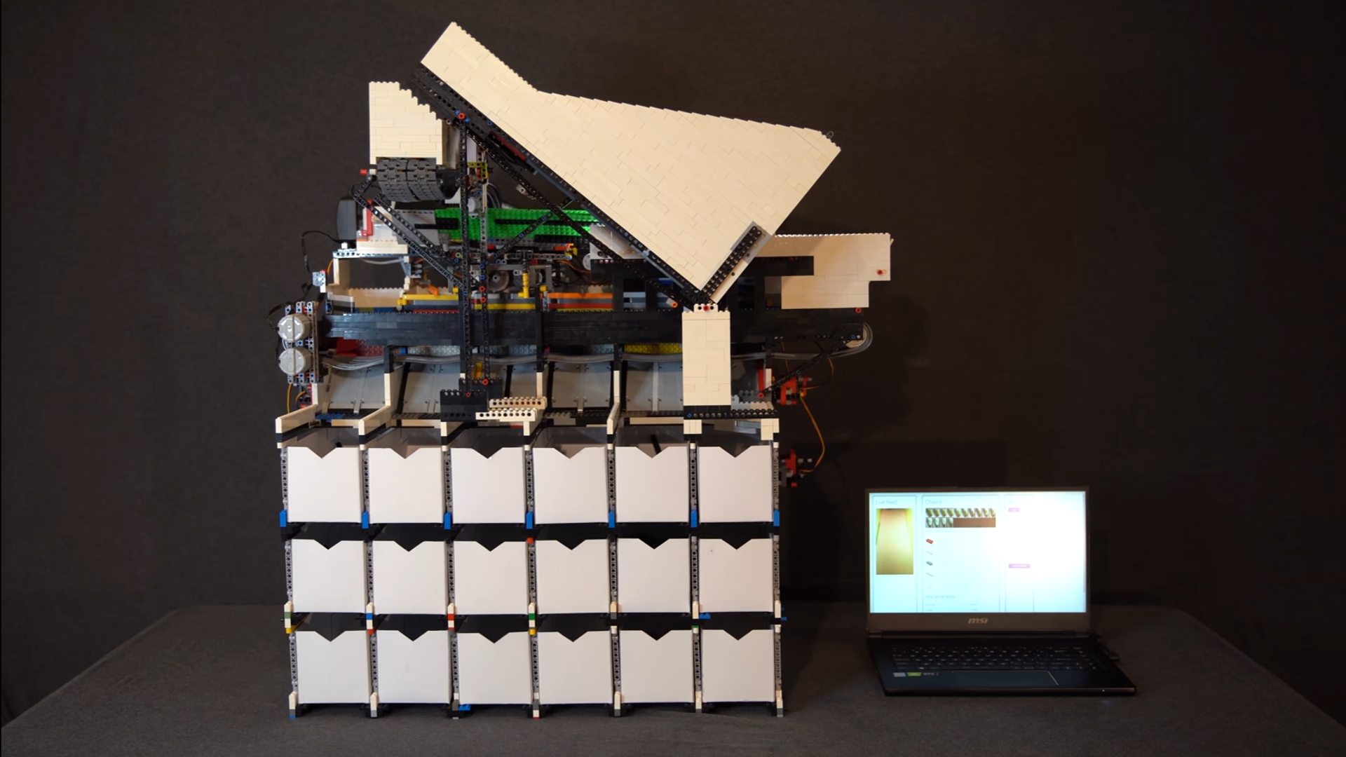 A sideview of a large LEGO sorting machine