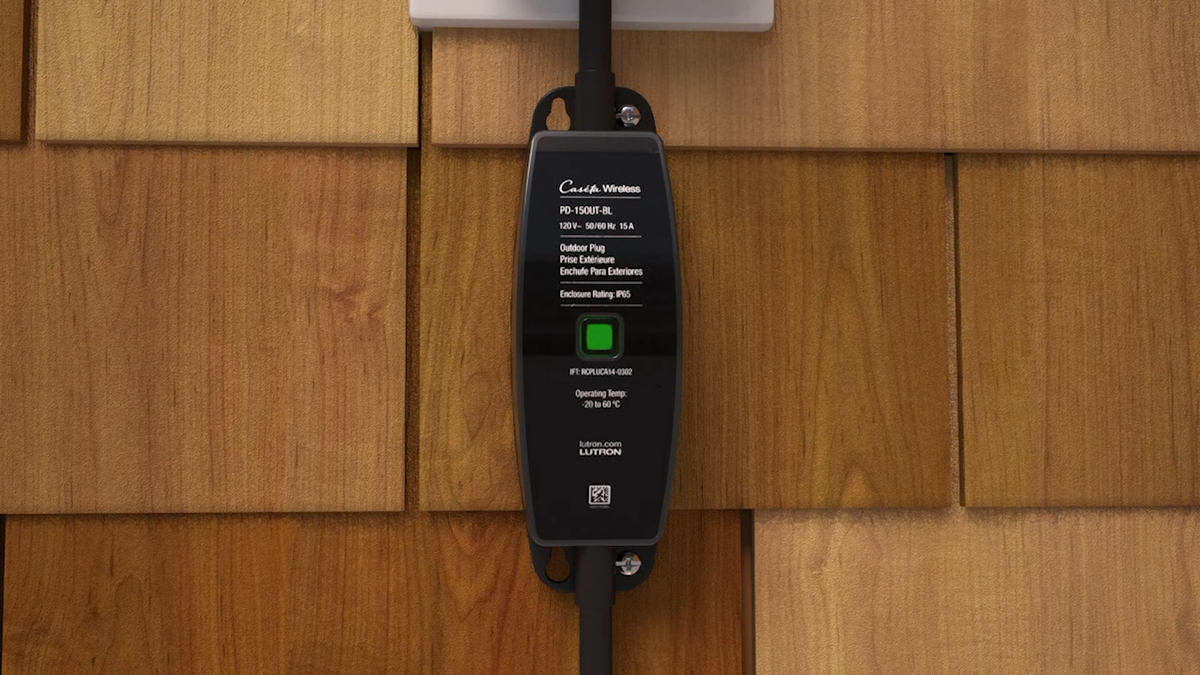 A long smart plug connected to an outdoor outlet.