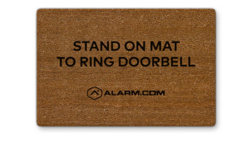 The Alarm.com Touchless Video Doorbell floor mat accessory.