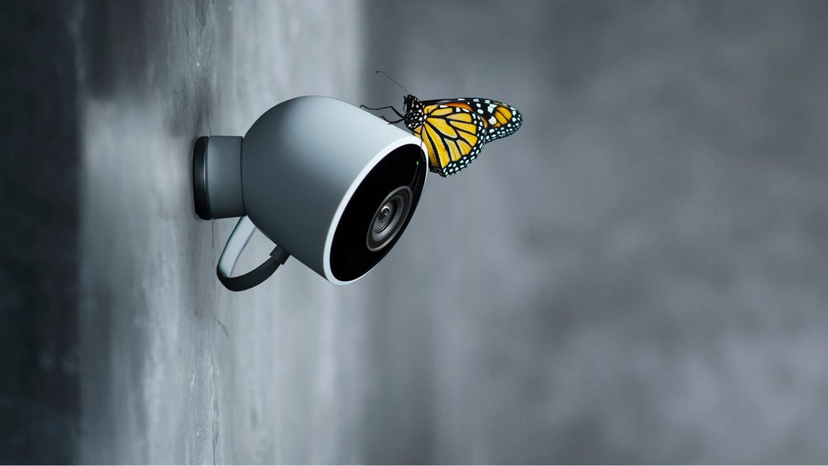 A Nest Cam Outdoor camera with a butterfly on it.