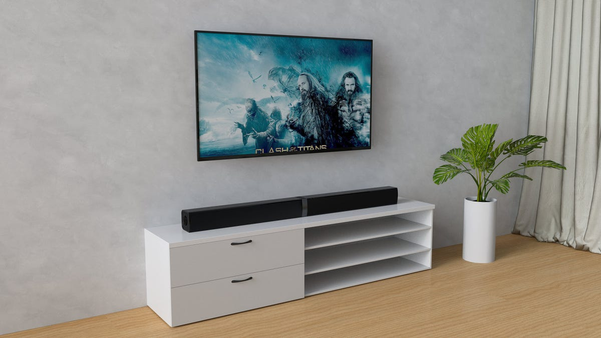A soundbar on a tv entertainment center.