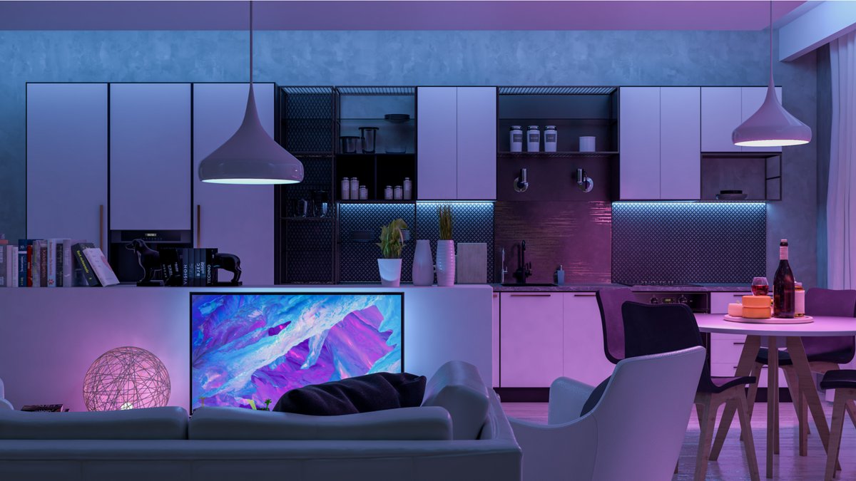 Modern living room with colored smart lights illuminating it