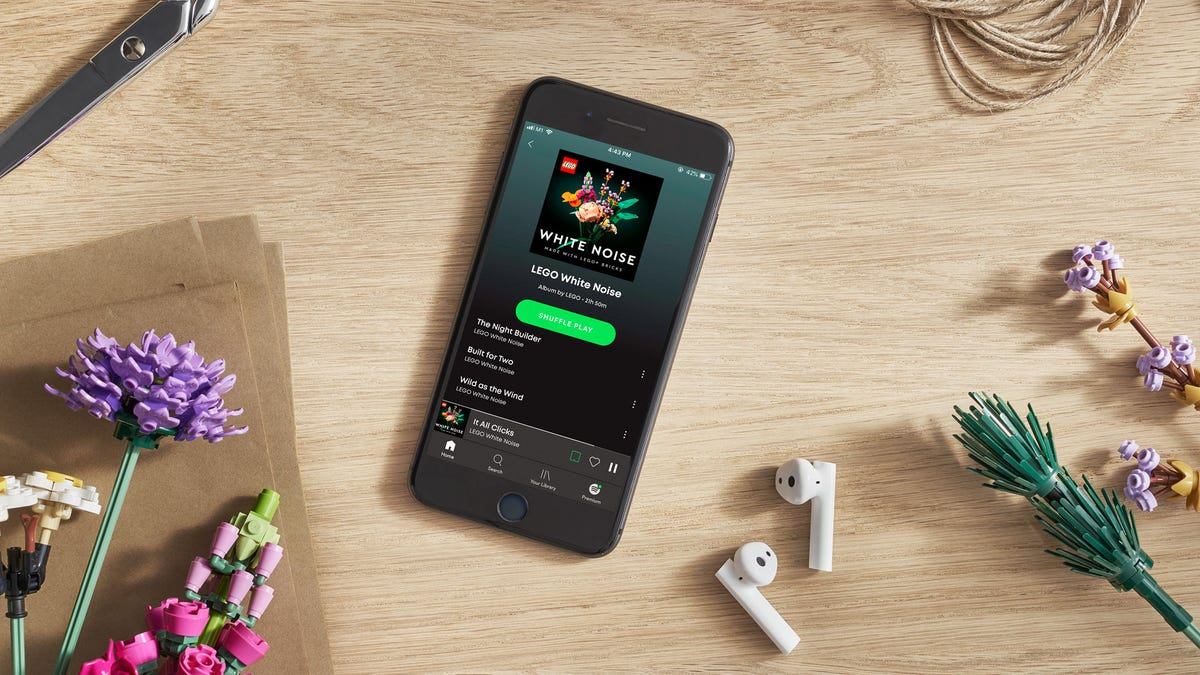 An iPhone with Spotify open to a LEGO White Noise album.