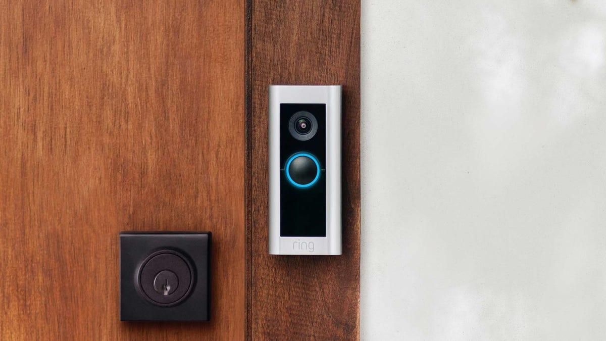 A Ring Video Doorbell Pro 2 on a wood door.