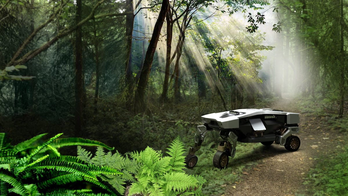 A Tiger X-1 vehicle traversing a forest.