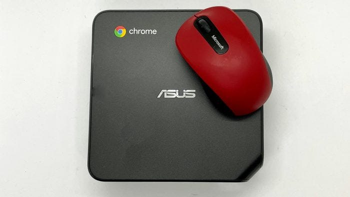 Image of a mouse laying on top of the Chromebox