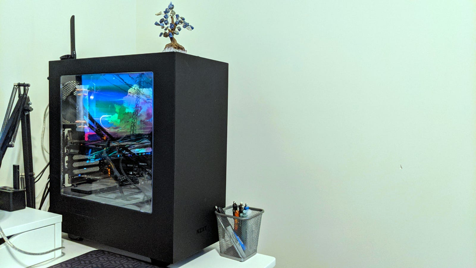 Custom computer on a desk against white wall