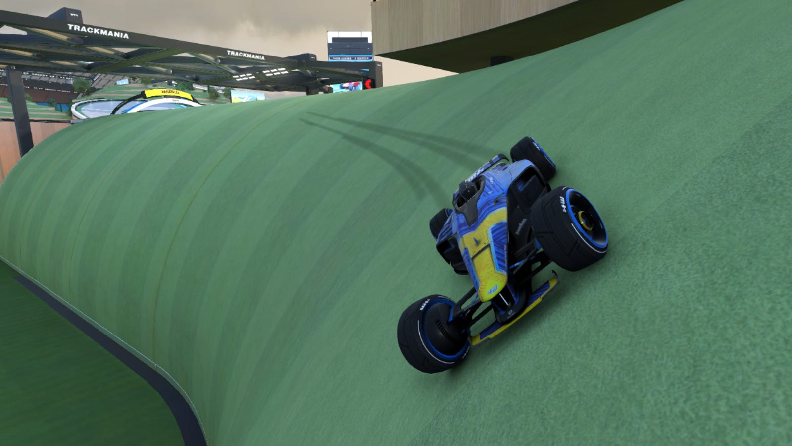 Car racing along grassy hill in 'Trackmania'