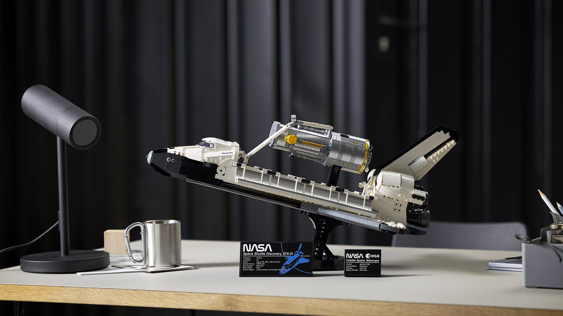 A closeup of the LEGO Space Ship Discovery, holding a Hubble Telescope
