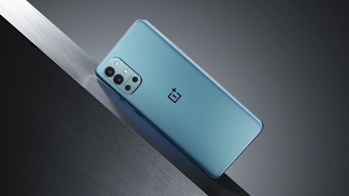 A OnePlus 9R phone in Lake Blue colors.