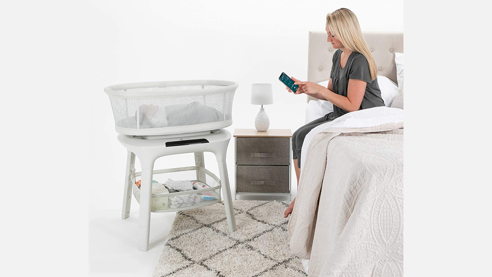 New mother watches over baby in crib