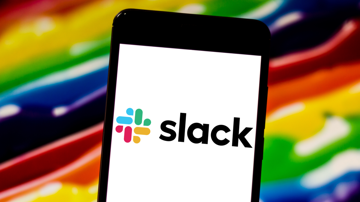 Slack app logo displayed on screen of smartphone against rainbow background