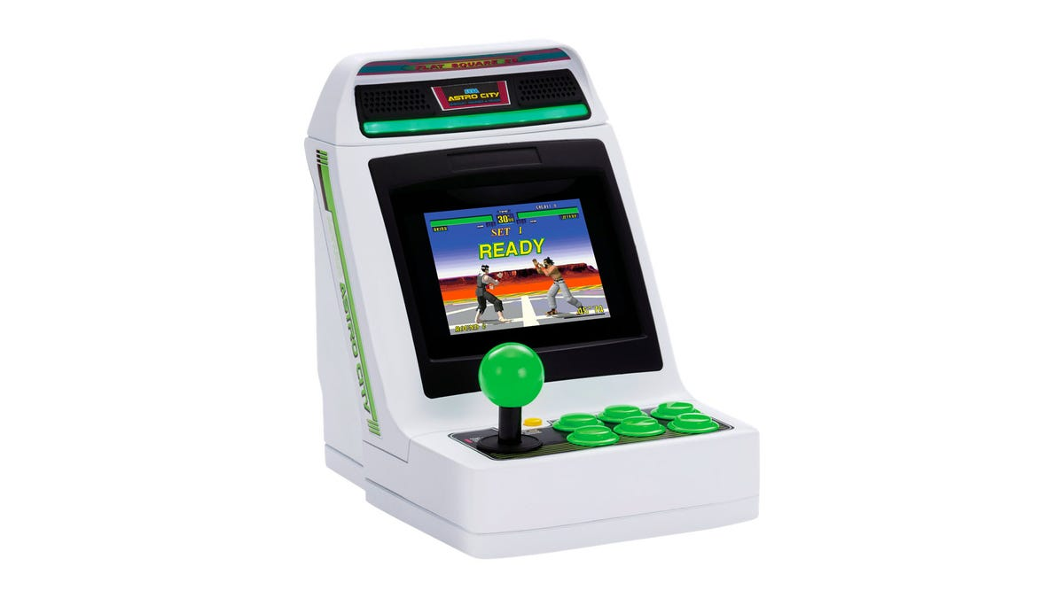 An Astro City Mini console with 'Virtua Fighter' on the screen.