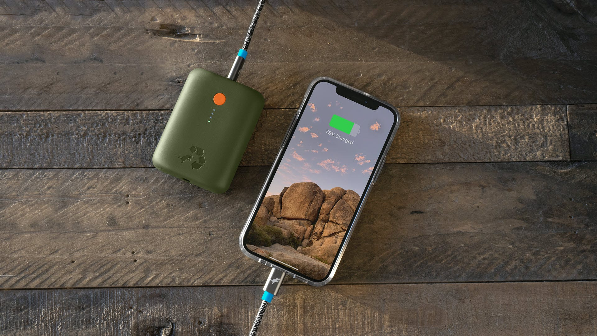 A Champ power bank plugged into an iPhone
