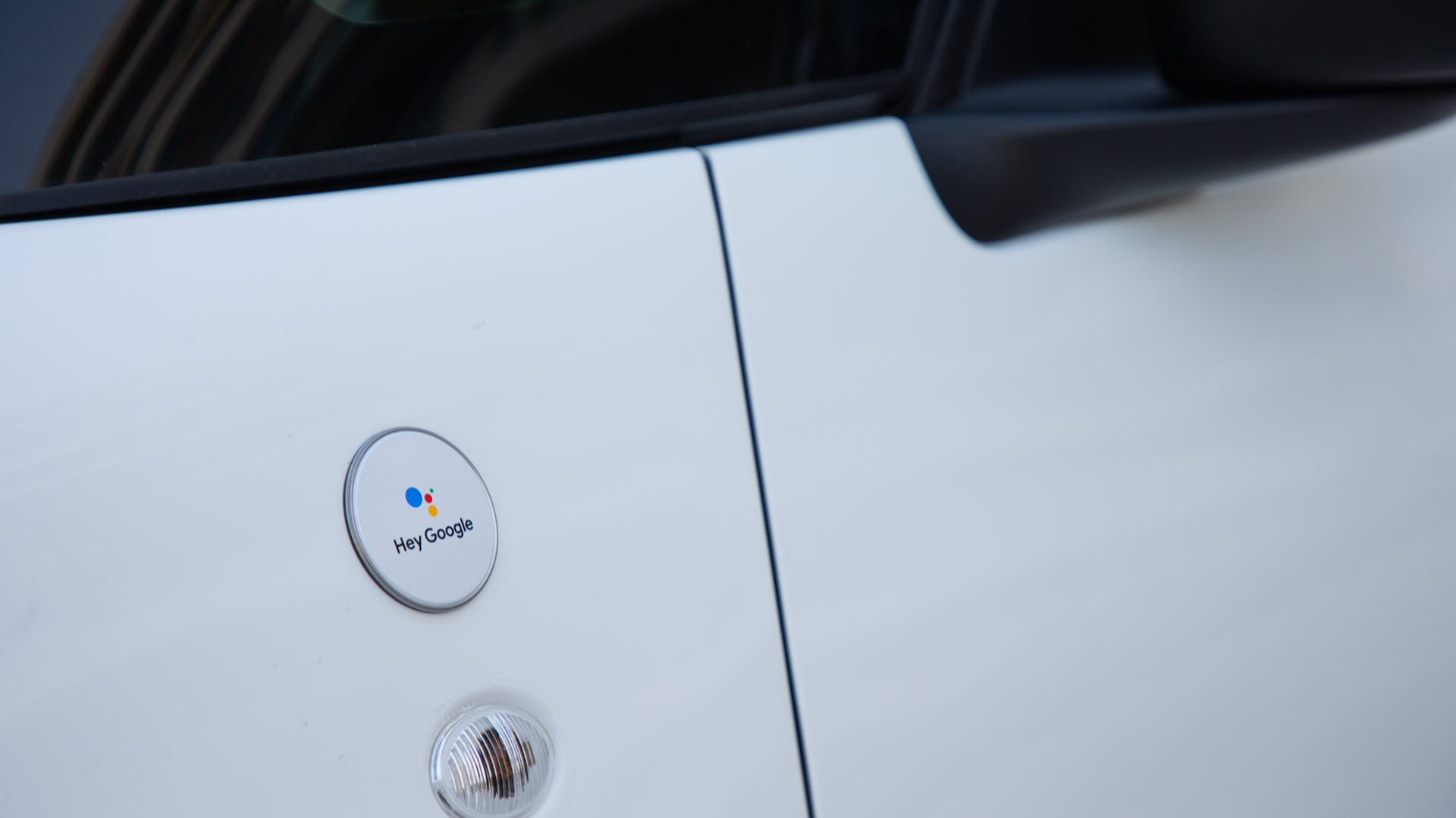 The side of a Fiat with a Hey Google badge