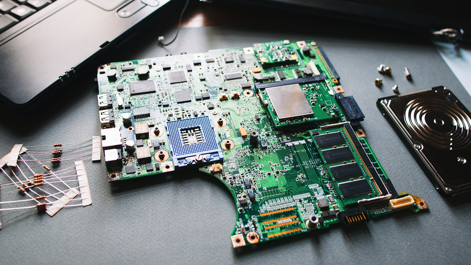 A laptop motherboard on a table.