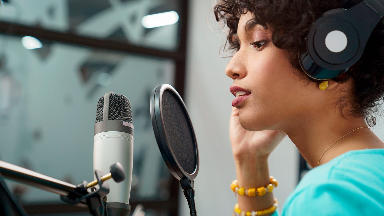 Woman speaking into a microphone in a studio