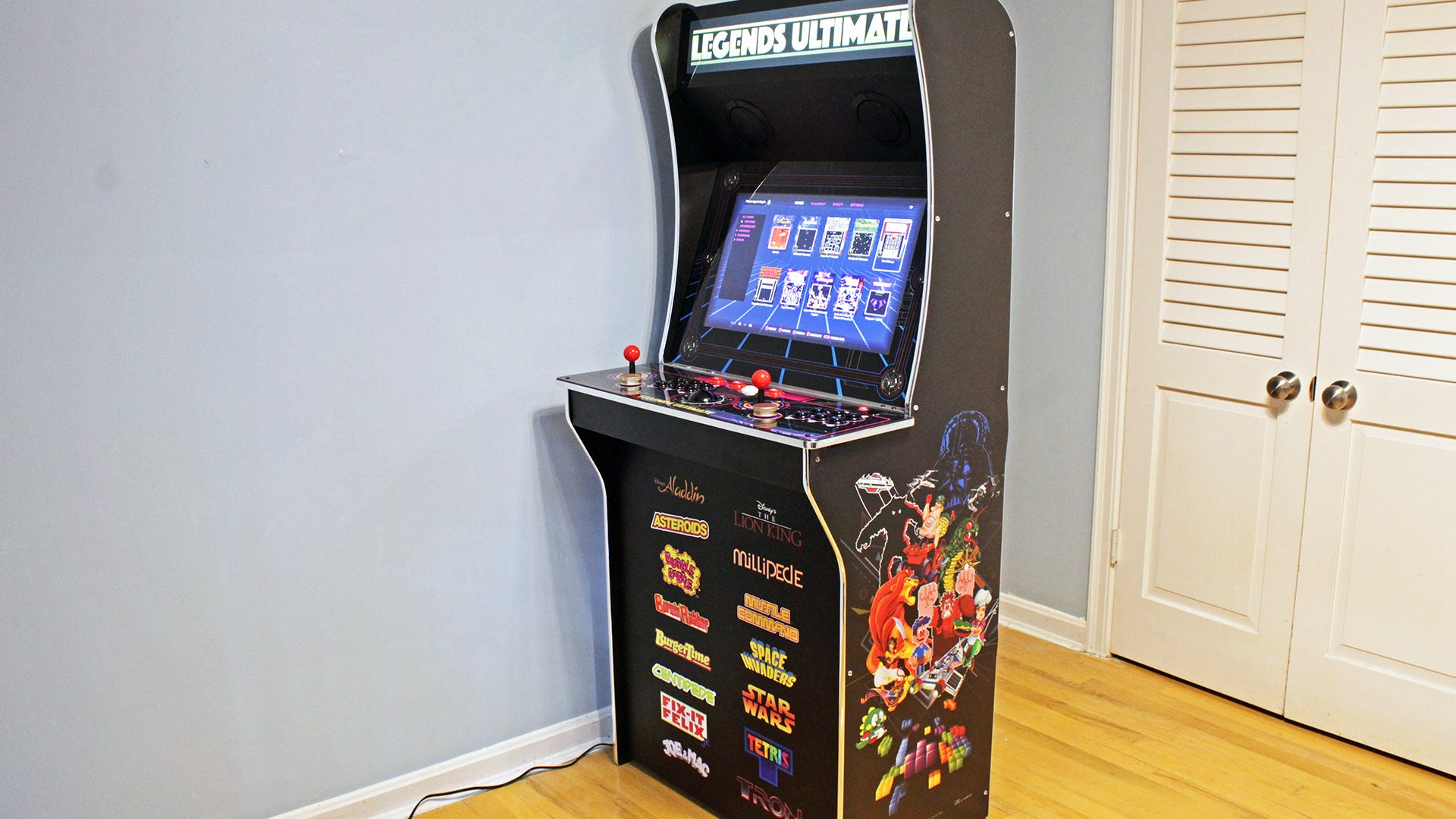 A three-quarter profile, showing artwork with various video game characters.
