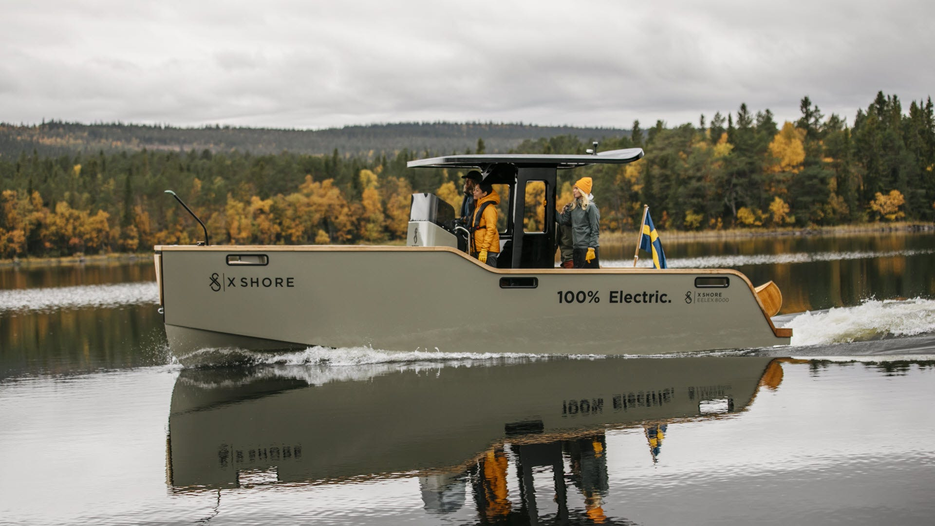 Full sideview of an electric boat.