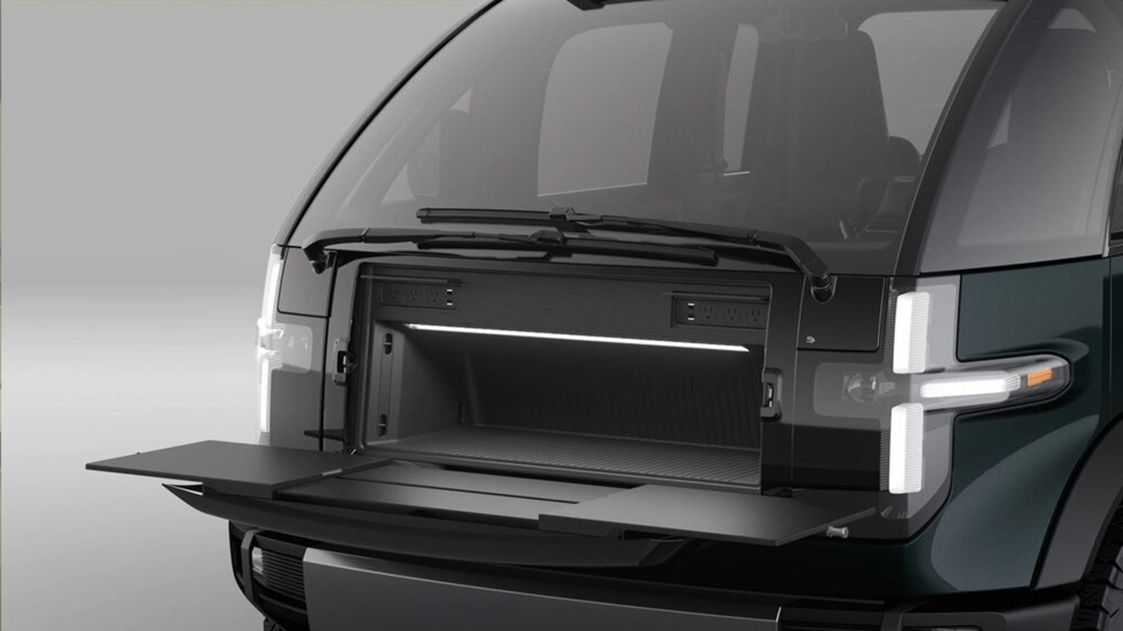 The front of the Canoo Pickup, with a fold-out workbench.