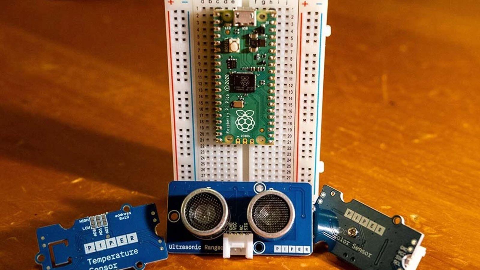 A Piper sensor kit next to a Raspberry Pi Pico