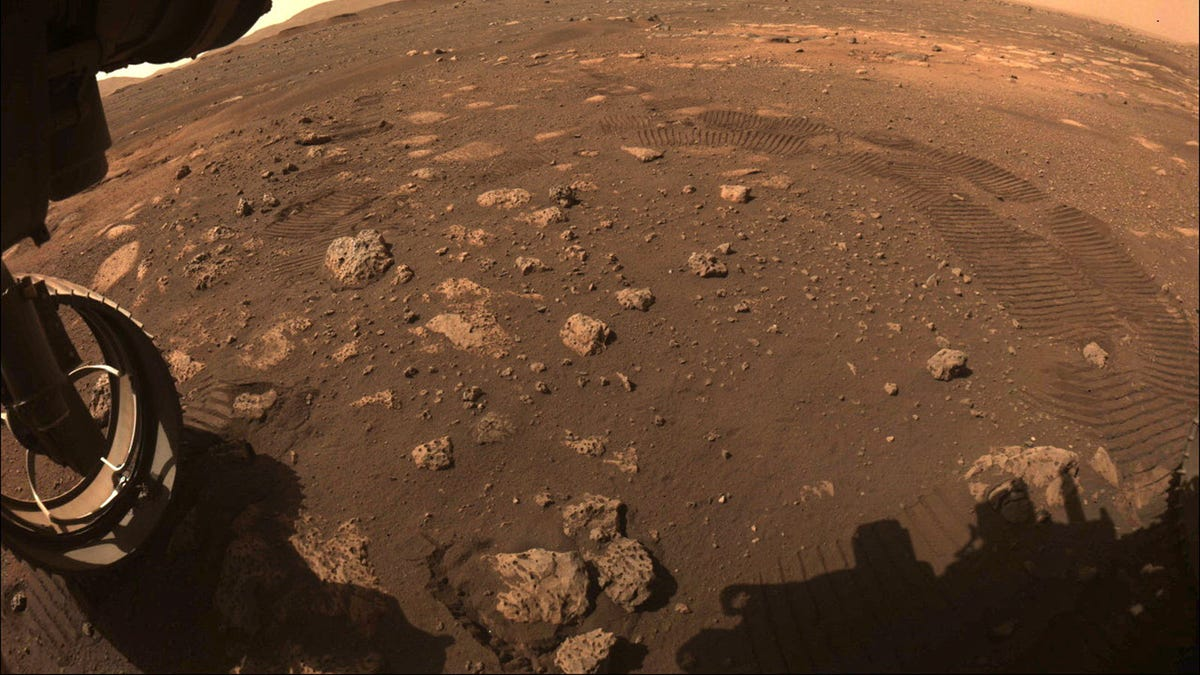 A few of the Martian horizon, with rover wheels just in sight.